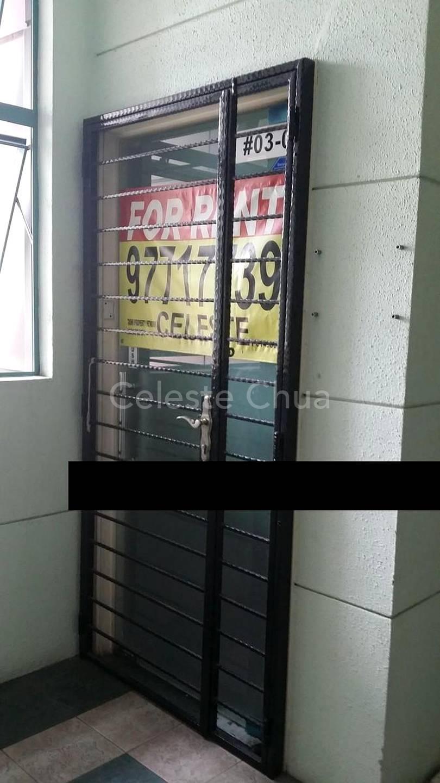 Glass door with metal gate