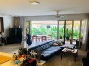 Spacious living room overlooking lush greenery