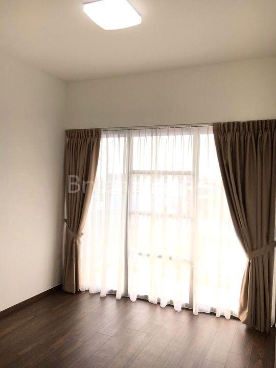 Bedroom after curtain installation