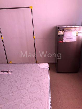fridge facing bed