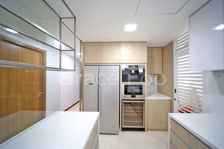 Good-sized fridge, coffee machine, microwave and wine cabinet.