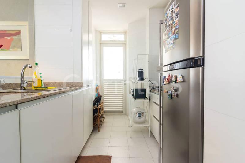 Kitchen with fridge, washer & stove